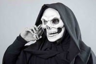A skeleton talking on a mobile phone
