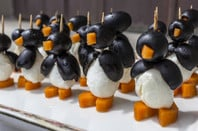 penguin entree army - black olives, carrot pieces and mozzarella balls pierced by toothpicks