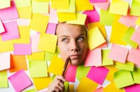woman surrounded by sticky notes