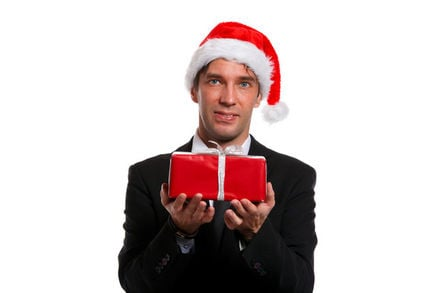hesitant looking man offers up christmas present