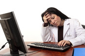annoyed doctor on pc