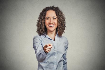 woman laughing at camera - pointing