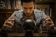 man gazes into crystal ball