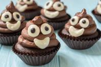 A cupcake made to look like a poo emoji
