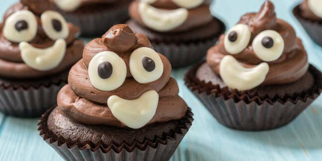 A cupcake made to look like a poo emoji