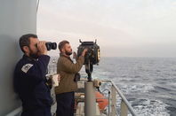Two Royal Navy ratings with an Aldis lamp on HMS Enterprise