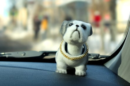 A nodding toy dog on the dashboard of a car