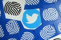 Twitter logo and fingerprints