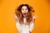 surprised looking woman - hair flying in the air