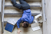 man falls down stairs, smashes laptop
