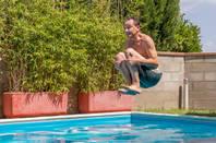 man divebombs into pool
