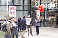 Protestors peacefully standing outside Google's London King's Cross HQ