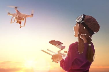 girl flies toy helicopter