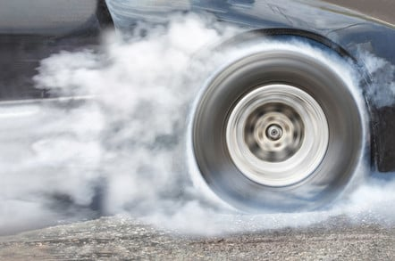 car speeds away - smoking wheels