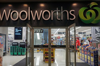 Unidentified people shop at Woolworths Supermarket in Sydney. Woolworths is Australian major grocery store chain in Oz