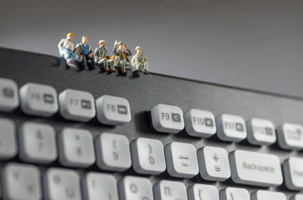 Figures of workers have a coffee break on a keyboard