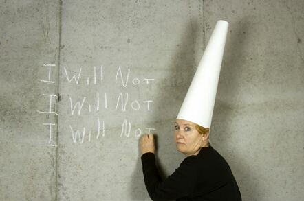 woman with dunce cap