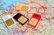 SIM cards with Europe map in background