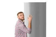man hugs fridge