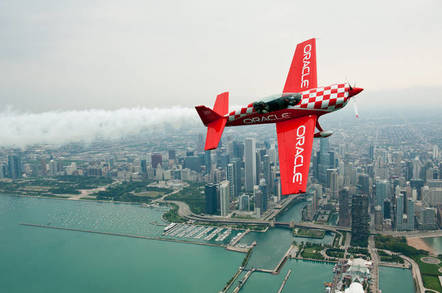 Team Oracle 8 ailerons custom built plane  flies in front of the Chicago skyline