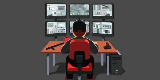 A guard watching TV monitors