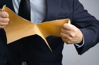 tearing up envelope/letter