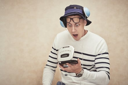 hipster shocked at compact disc player