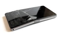 Damaged and bent black mobile phone