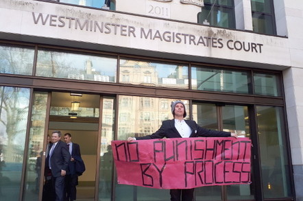 Lauri Love outside Westminster Magistrates' Court today. Leaving is building is barrister Andrew Bird for the NCA