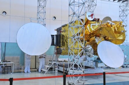 Nigerian satellite with the L-band antenna draped in a fetching red ribbon