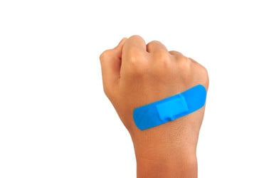 blue plaster/bandaid on small fist microsoft patch