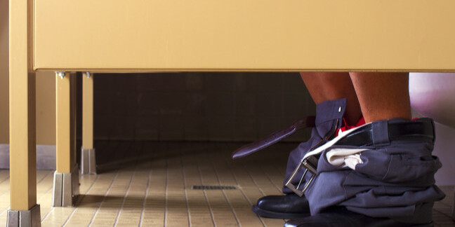 man on office loo pants down