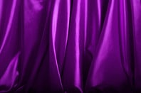 Purple silk background close up
