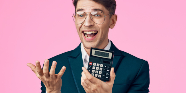 man happy with his calculator
