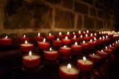 Votive candles in a church in Belgium