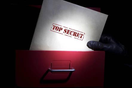 Stealing top secret folders- photo from shutterstock