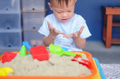 boy with sandbox dirty hands