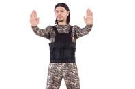 man in camouflage in bulletproof vest