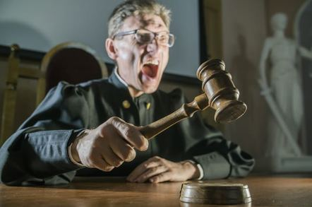 Angry judge slamming gavel