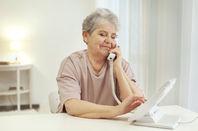 older woman dials landline