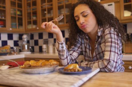 Woman tasting apple pie