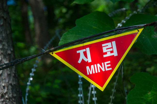 sign warning of land mines in korea's dmz
