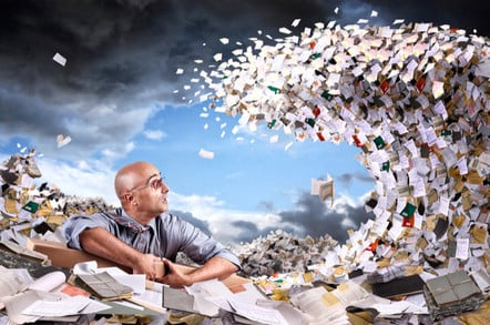 man about to become submerged by giant wave of paperwork