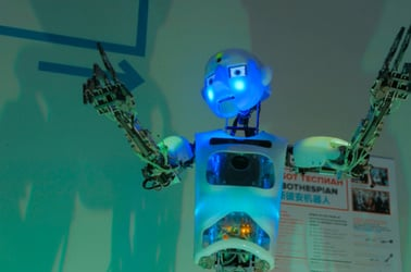 singing funny humanoid robot at tech exhibition