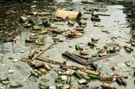 Image of trash-strewn pond