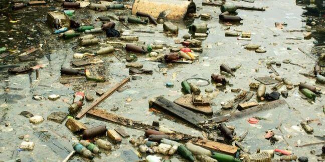 Image of trash-strewn pond