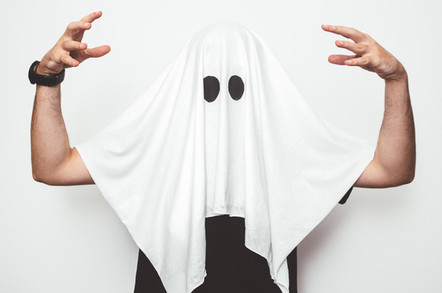 Man wearing ghost costume