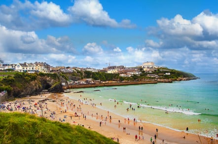 Busy beach during peak season in Newquay, Cornwall, UK