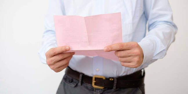 Shutterstock image of a man with a pink slip