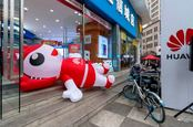 Huawei store in China with fallen promotional inflatable character on the ground